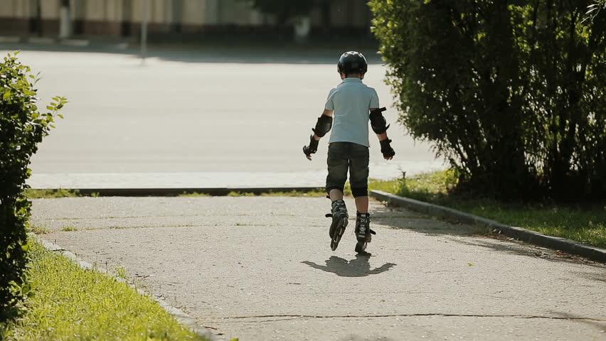 A little boy learning to roller skate | Shutterstock HD Video #11244845