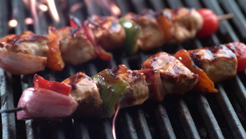 Chicken skewers on grill, shot on Phantom Flex 4K