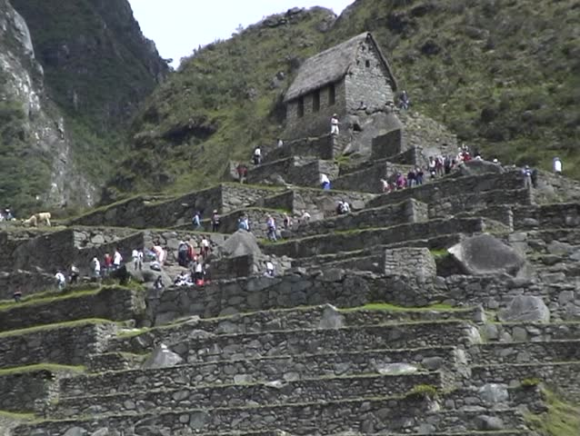 Crowds of tourists at the classic viewpoint of the Ancient Inca city of Machu Picchu, Peru.