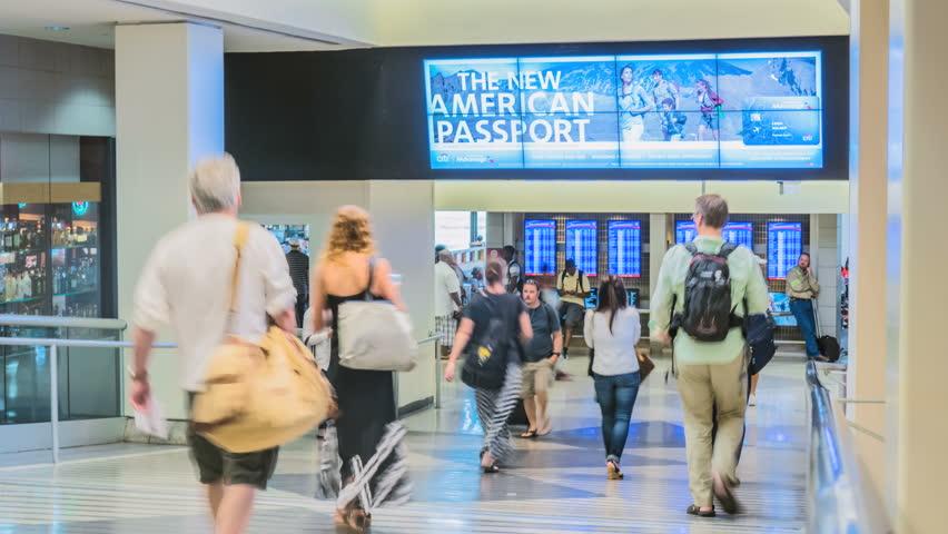 PHILADELPHIA, PA - AUG 15: (Timelapse) Crowd of people at busy Philadelphia International Airport on August 15, 2015. Philadelphia Airport is an international hub in Pennsylvania, United States.