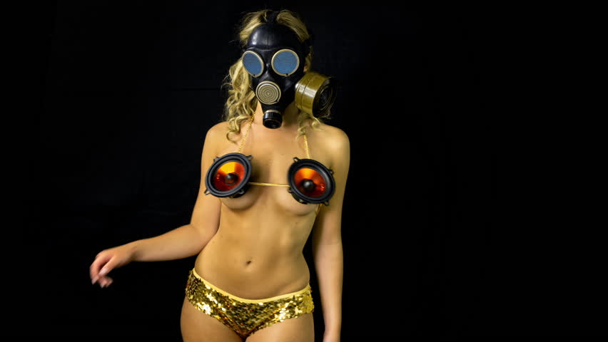 sexy woman with beautiful body dances with a gas mask covering her face. Good clip for party, fetish, industrial or warfare