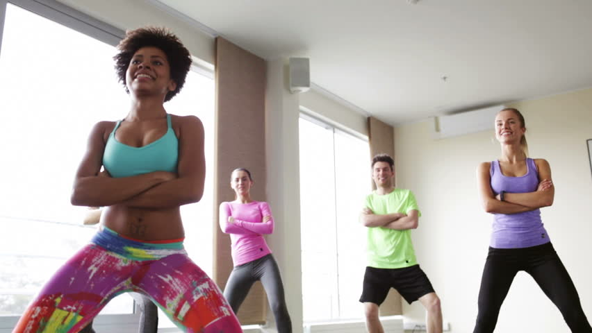 fitness, sport, dance and lifestyle concept - group of smiling people with coach dancing zumba in gym or studio Royalty-Free Stock Footage #11266904
