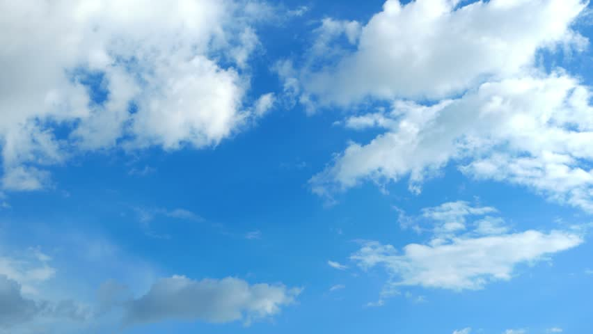 Blue daylight summer sky with fluffy white clouds as nature image. Time lapse shot. #11272277