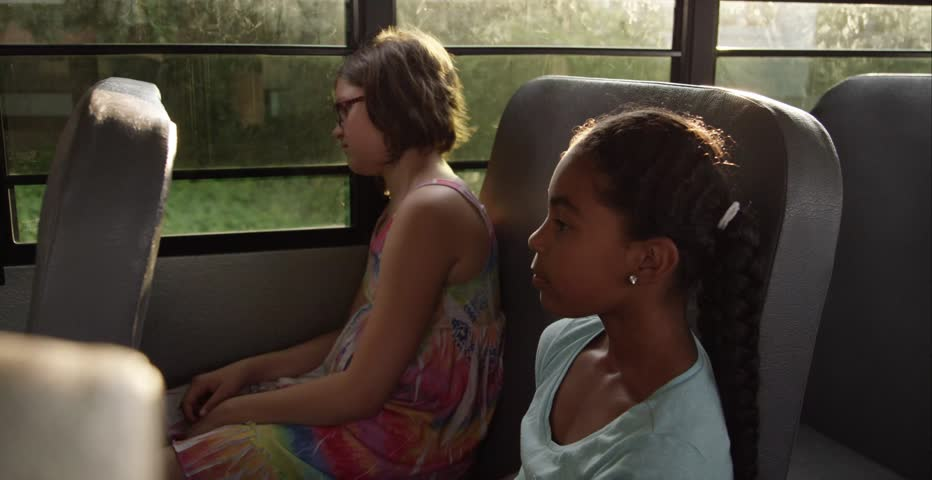 Sad friend being cheered up on the school bus | Shutterstock HD Video #11291900