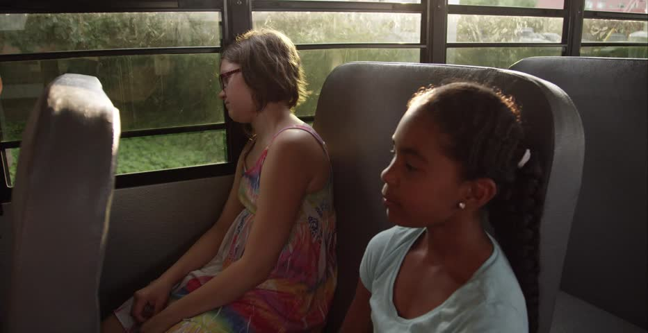 Friends on the school bus - cheering up sad student | Shutterstock HD Video #11306234