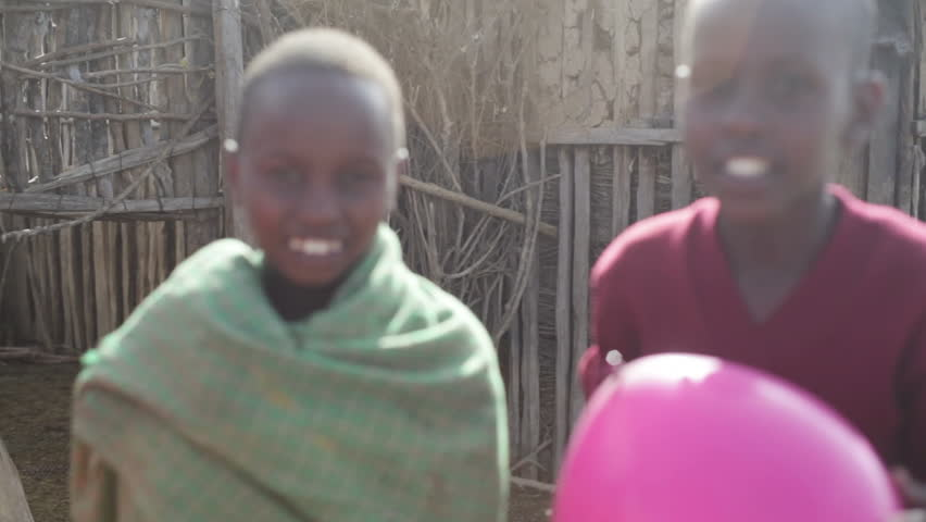 KENYA - CIRCA JULY 2013 - African children smile with balloons, lens flare, Samburu, Kenya | Shutterstock HD Video #11345978