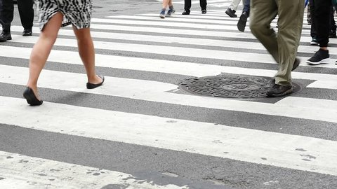 Unidentified people crossing the street in New York City.