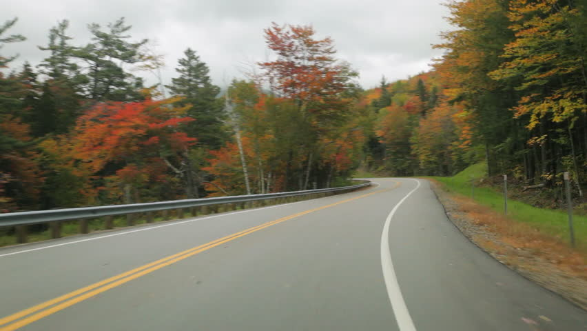 Driving POV on the Kancamagus Highway in the White Mountains of New Hampshire in Autumn.