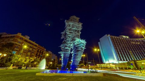 """August 2015 Athens,Greece.4K night timelapse of the runner (""""Dromeas"""") statue downtown, located at the Square of the """"Great School of the Nation"""", opposite to the famous Hilton Hotel,"""