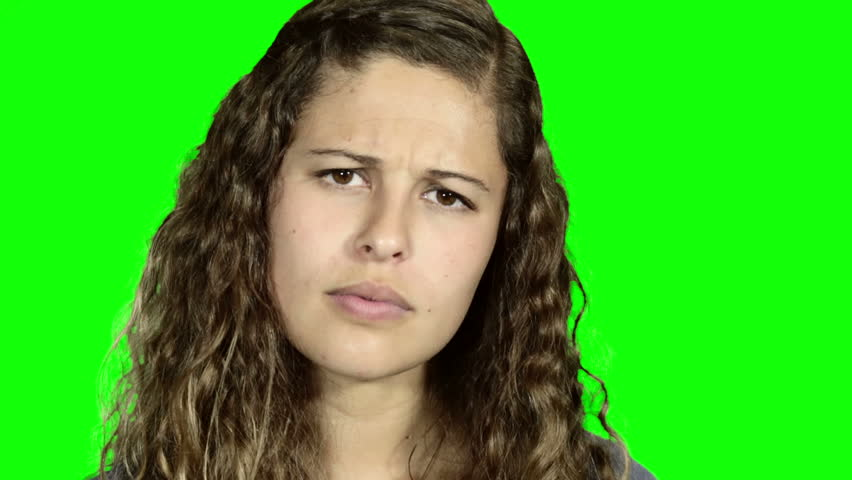 Green screen: Beautiful girl  turns to camera, tilts her head and raises her eyebrows, looking cynical, suspicious, and disbelieving, her hand on her chin. | Shutterstock HD Video #11392598