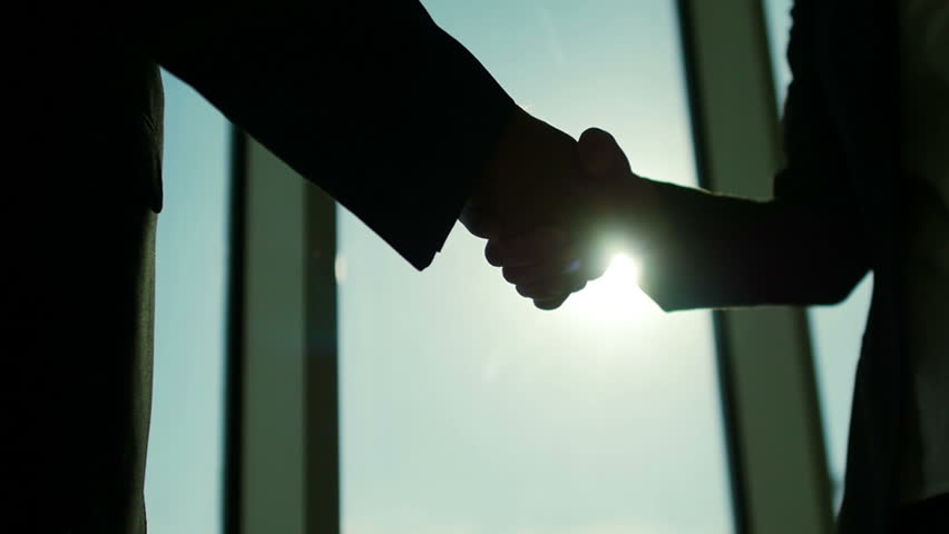 Two business partner shake hands when meeting. In slow motion | Shutterstock HD Video #11397452