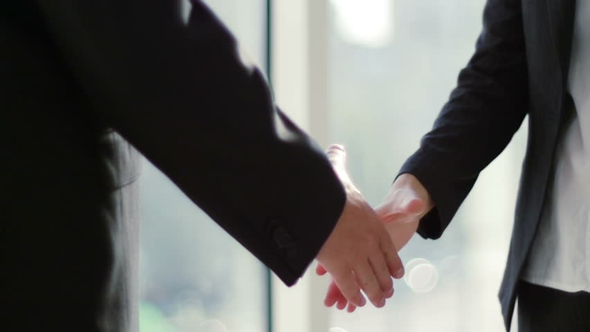 Two business partner shake hands when meeting. In slow motion #11397467
