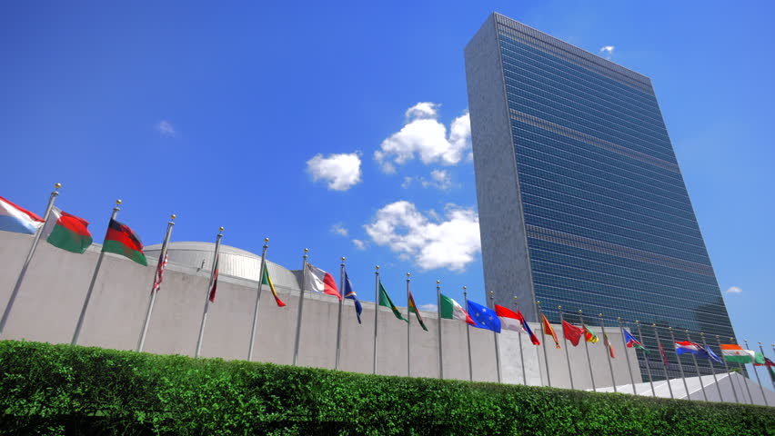 NYC United Nations building, headquarters in New York City and flags of the members countries, panning view