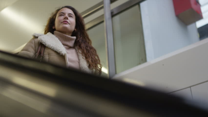 4k Young, attractive woman going down the subway escalator. Shot on RED Epic. | Shutterstock HD Video #11473751