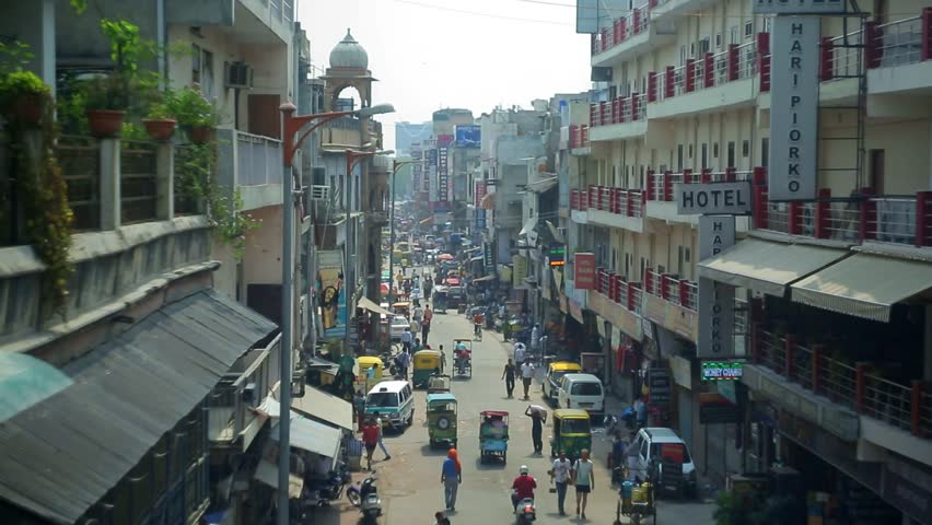 New Delhi, INDIA - June 18-14: Day view of Main bazar Pahar Ganj street in Delhi. People, cars, motorbikes and auto rickshaws on the street n New Delhi on June 18-14 #11483432