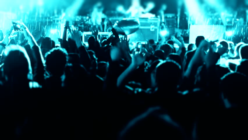 People cheer move lift and clap their hands in unison against the strobing stage lights Concert Arena Sound waves night night rock concert front row crowd cheering nightclub silhouettes dancing  party | Shutterstock HD Video #11494343