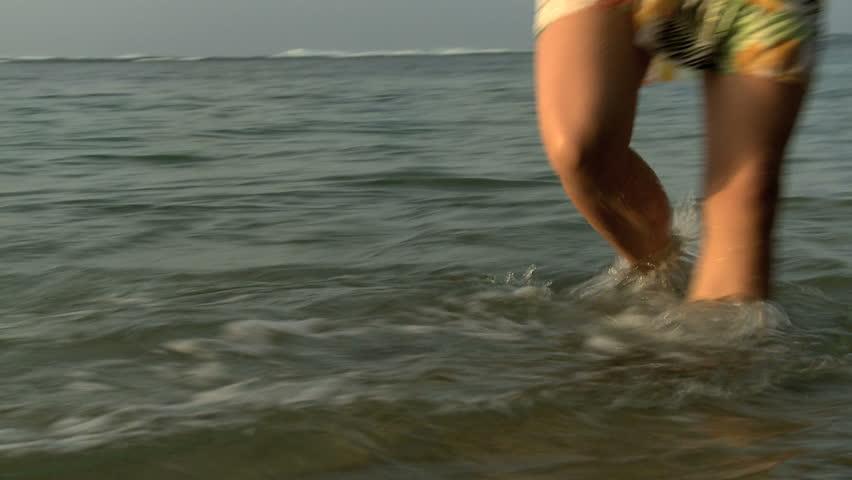 Woman splashing in the ocean | Shutterstock HD Video #11505125