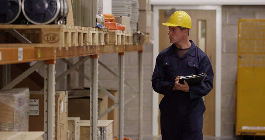 Warehouse manager inspecting stock levels in a manufacturing plant. Shot on RED Epic. | Shutterstock HD Video #11532572