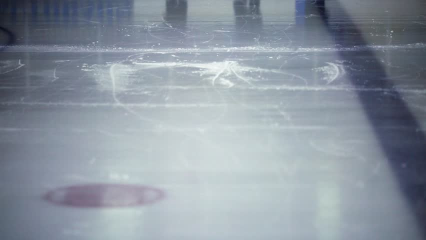 Shot of ice skaters' legs as they play hockey at ice rink.   | Shutterstock HD Video #11540573