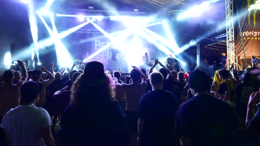 TOLMIN, SLOVENIA - JULY 24: Moshpit on a Betraying The Martyrs concert at the Metaldays festival on July 24, 2015 in Tolmin, Slovenia.  | Shutterstock HD Video #11549678