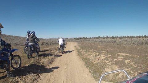 DELTA, UTAH - MAR 2014: Off road ATV and motorcycle dirt bikes Utah desert. Riding side-by-side ATV RZR through the desert of western Utah. Fun recreation in nature. Little Sahara Recreation area