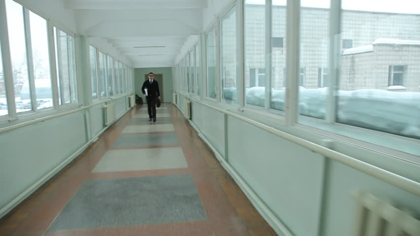 man walking quickly along the corridor. Hurry