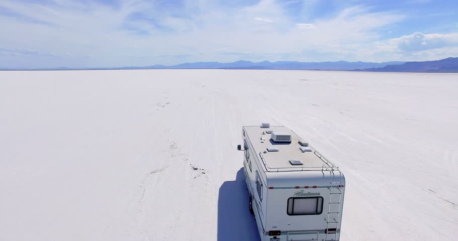 Bonneville, Utah, USA-August 4, 2015. Driving motorhome on Bonneville Salt Flats, Utah.