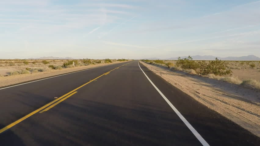 Point of view vehicle driving shot of California Highway 62 through the Mojave desert. Viewpoint of driver over smooth blacktop asphalt on a stretch of desert highway.   Shutterstock HD Video #11596064