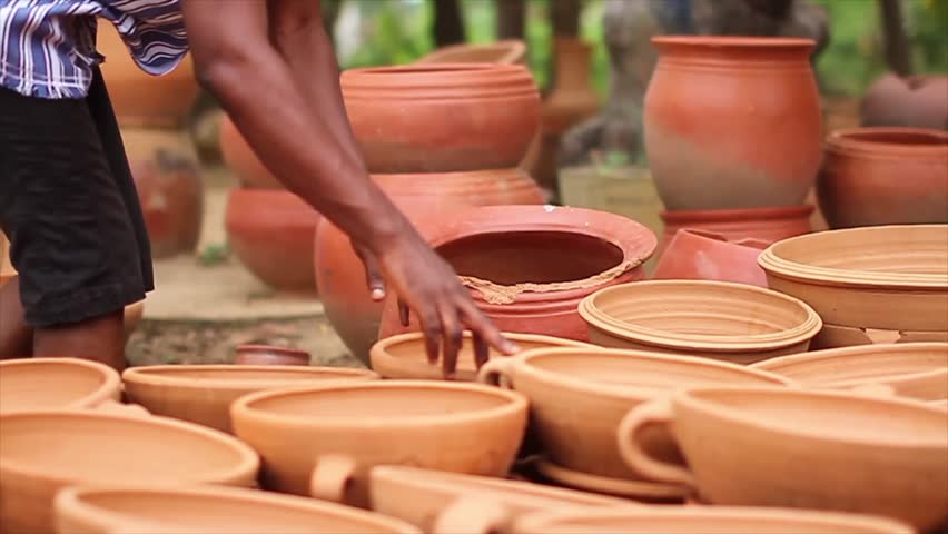 Hands counting Clay pots  | Shutterstock HD Video #11616311
