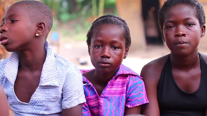 Black African children sitting quietly, Akosombo  Ghana, December 2012