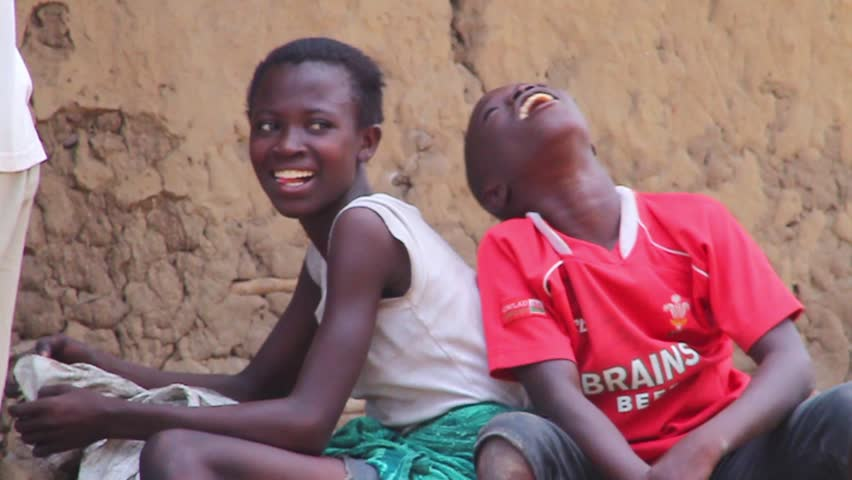 Boy and a girl sitting happily, December 2012, Akosombo