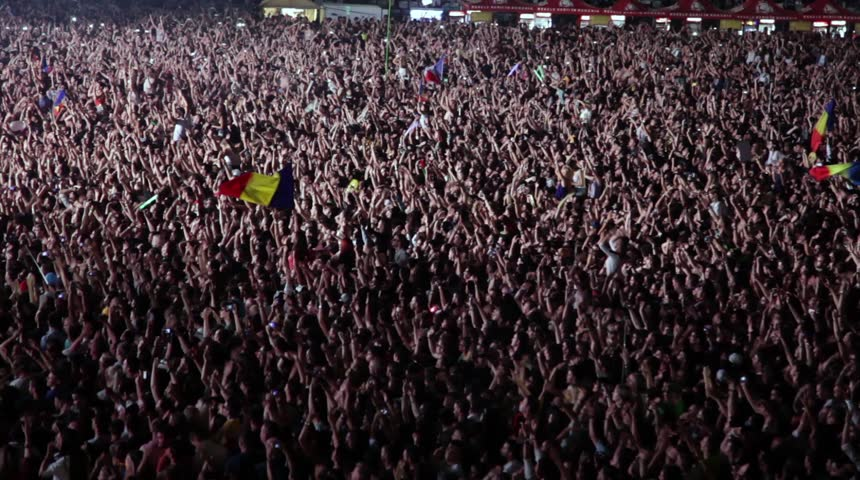CLUJ-NAPOCA, ROMANIA - AUGUST 3, 2015: Crowd having fun during a live concert at Untold Festival in the European Youth Capital city | Shutterstock HD Video #11630117