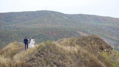 SAMARA, SAMARA REGION/RUSSIA - SEPTEMBER 05: The bride and groom are on the mountain, telephoto shooting on September 05, 2015 in Samara
