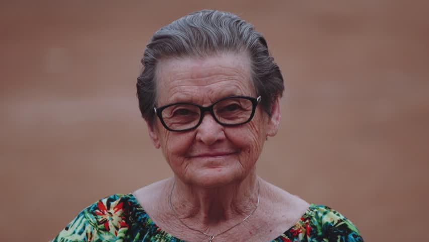 Smiling elderly woman looking at camera | Shutterstock HD Video #11652392
