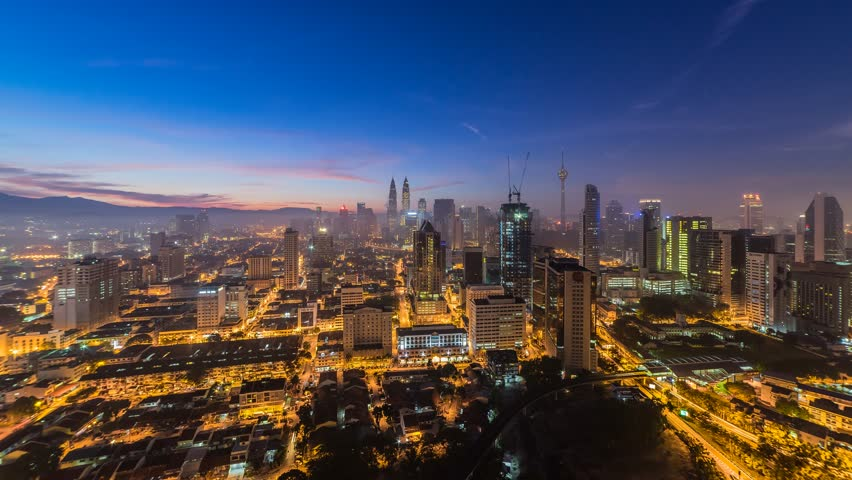 KUALA LUMPUR - June 6: Timelapse view of traffic and pedestrians near The Petronas Towers on June 6, 2015 in Kuala Lumpur, Malaysia. | Shutterstock HD Video #11655587