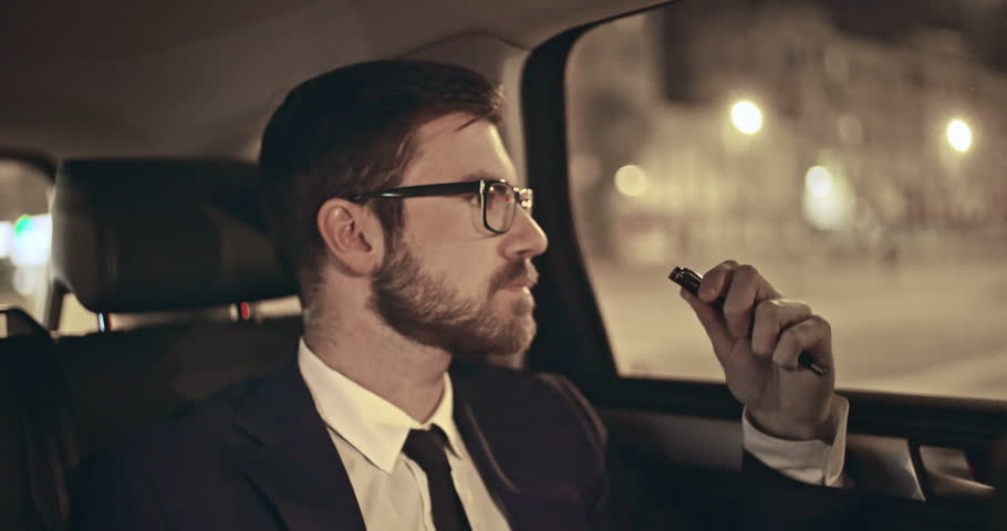 Young manager answering mobile phone in back seat of moving car | Shutterstock HD Video #11668067