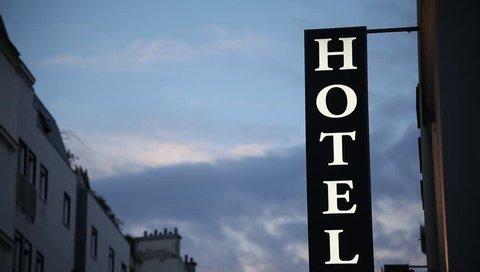 hotel building establishing shot in twilight