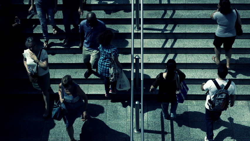Birds eye view slow motion people walking steps to underground entrance.100-25p conformed super slow motion hd clip of an overhead view of people walking towards and away from the  train station. | Shutterstock HD Video #11677694