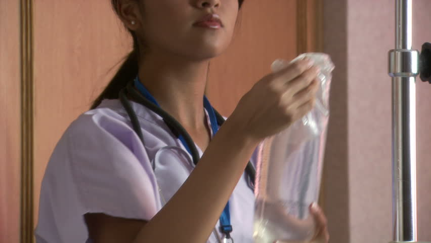Female nurse adjusting IV Pump | Shutterstock HD Video #11681492