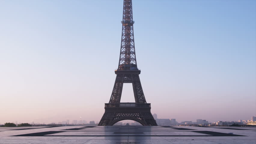Woman running in front of the Eiffel tower | Shutterstock HD Video #11697851