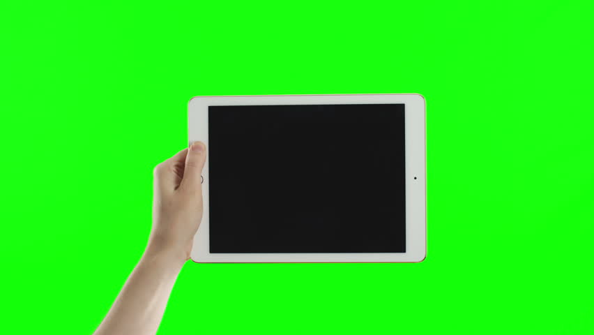 Female hand holding the new tablet on green screen. No need in green or blue screen into the tablet. You can track it easily putting the trackers on the screen corners. Cinema frame rate 23.97 fps.