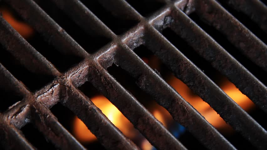 Grill with gas flames beneath.