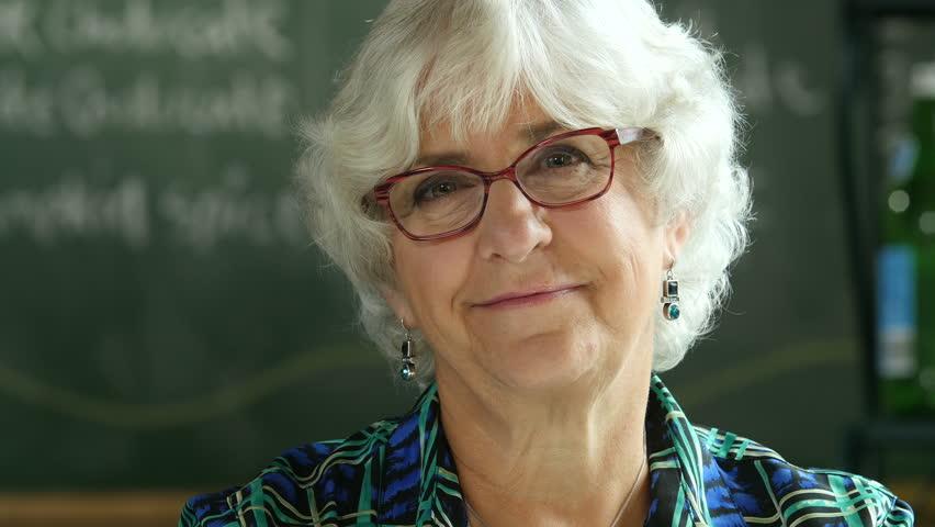 Portrait of a senior woman, smiling, close up shot