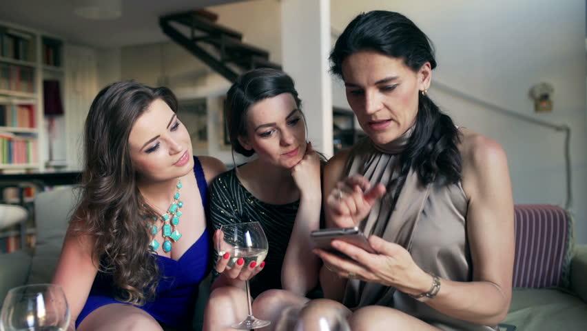 Girlfriends receiving good news at the party, steadycam shot  | Shutterstock HD Video #11723708