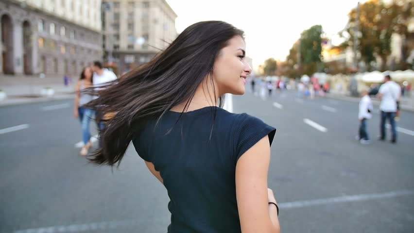4 in 1 video! The young woman walk, turn and smile in the center city by building background. Camera follow behind. Slow motion capture.  | Shutterstock HD Video #11725718