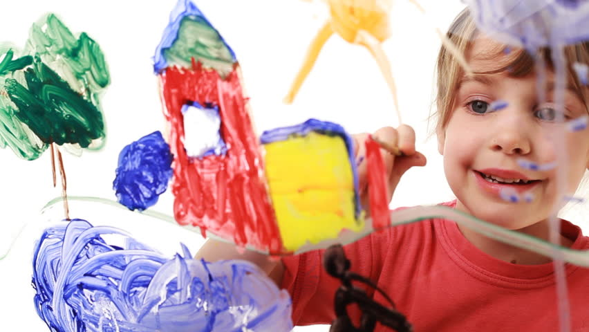 nice little girl paint himself at home in picture on transparent glass, behind white background