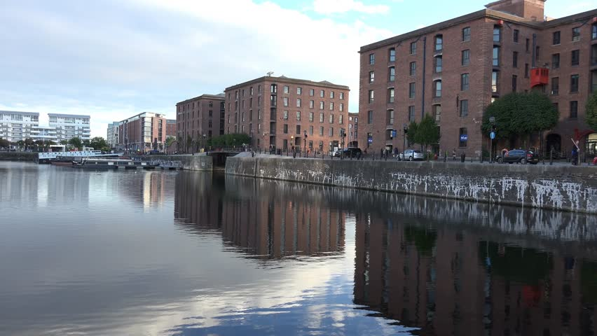 4k Albert docks in Liverpool, with reflection of buildings in water