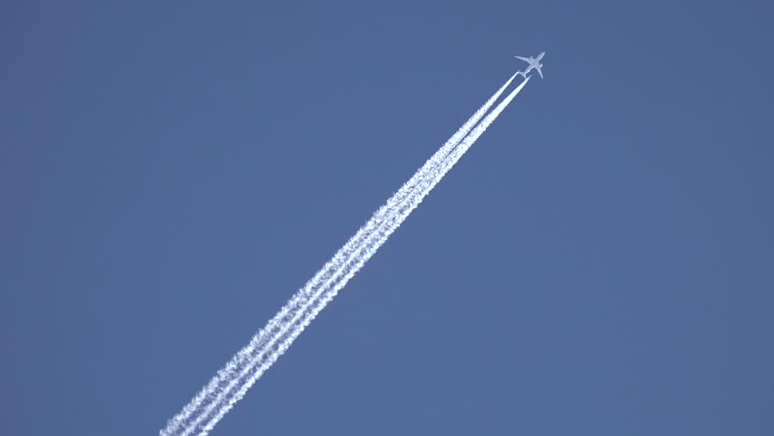 4K View of Airplane jet layer, aircraft pollution on sky, white trace vapour by day #11778167
