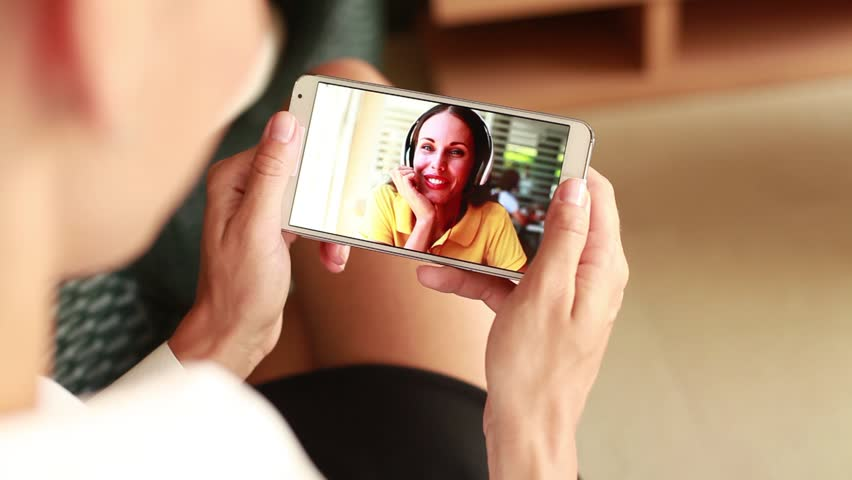Woman talking to a friend on video call on smart phone | Shutterstock HD Video #11796095