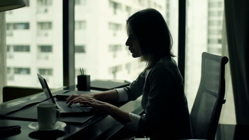 Young businesswoman working on laptop sitting by desk in office  | Shutterstock HD Video #11826896